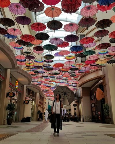"Sings ""under my umbrella ela ela eh eh eh"" Indoors  Multi Colored Architecture Day People DubaiMall Arrangement Photography Dubai United Arab Emirates EyeEm Gallery EyeEm Best Shots Lights And Shadows EyeEm Design Umbrella Rethink Things"