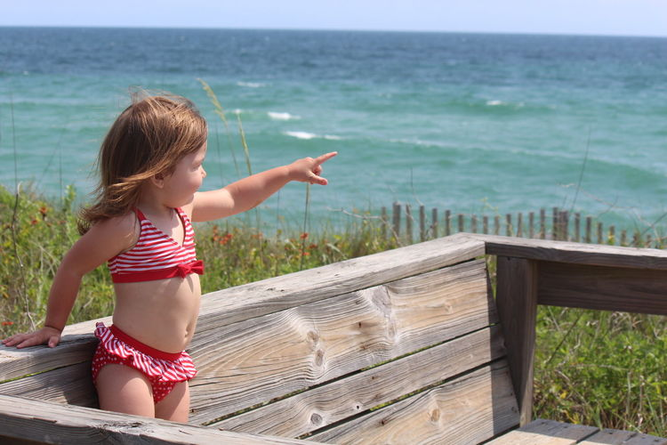 Beauty In Nature Casual Clothing Day Grass Idyllic Landscape Leisure Activity Lifestyles Nature Outdoors Relaxation Scenics Sky Tranquil Scene Tranquility Vacations Water Little Girl In Bathing Suit Looking Out To The Ocesn