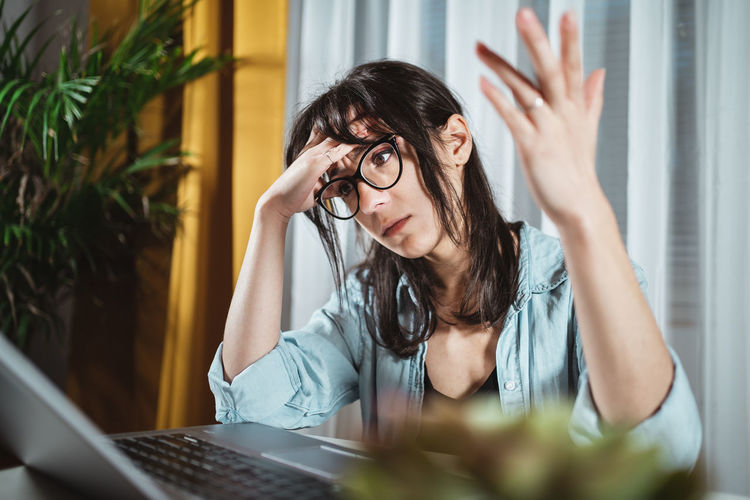 Exhausted businesswoman sitting at home