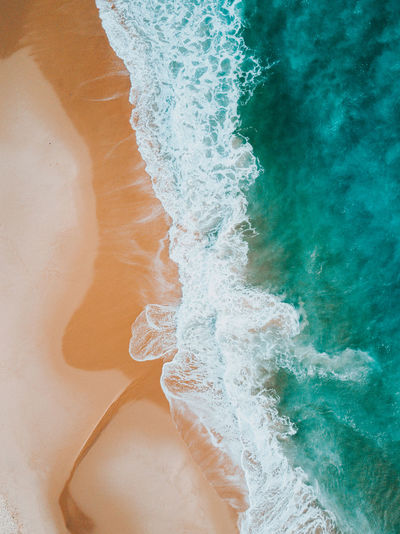High angle view of wave on beach