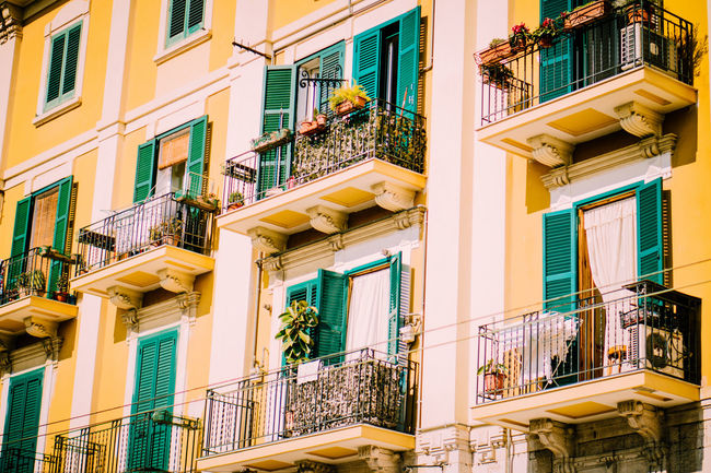 Apartment Architecture Balcony Building Exterior Built Structure City City Life Contrast Day House Housing Development Multi Colored No People Outdoors Residential Building Townhouse Window Yellow