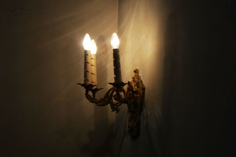 Illuminated Candle Indoors  Dark Glowing Lighting Equipment No People Close-up Wall - Building Feature Candlestick Holder