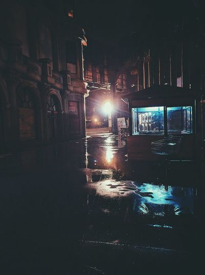 People And Places Night Street Illuminated Building Exterior Rain Street Light Reflection City Life No People Nexus 6P Huaweiphotography India Wet Night Street Illuminated Road Building Exterior Built Structure Architecture Rain Street Light Transportation Dramatic Angles