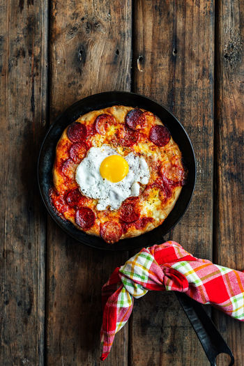 High angle view of breakfast sourdough skillet pizza