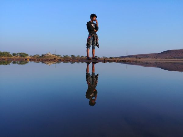 EyeEm Selects Water Water Reflections Upside Down Reflection One Person Full Length Adults Only Only Women Adult One Woman Only Outdoors Sky People Lake Standing