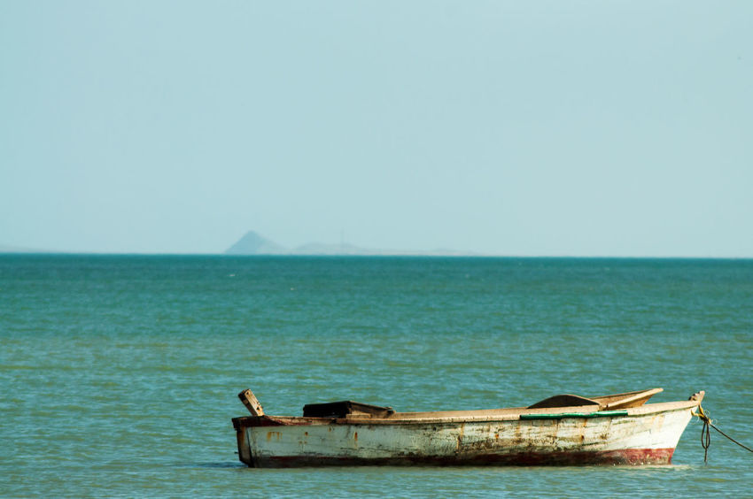 Old worn out wooden boat in the Atlantic Ocean Arid Climate Colombia Countryside Desert Desolate Dry Earth Environment Ground Heat Hot Isolated La Guajira La Guajira Colombia Lagoon Natural Nature Nobody Outdoor Outdoors Sand Scene Summer Travel Water