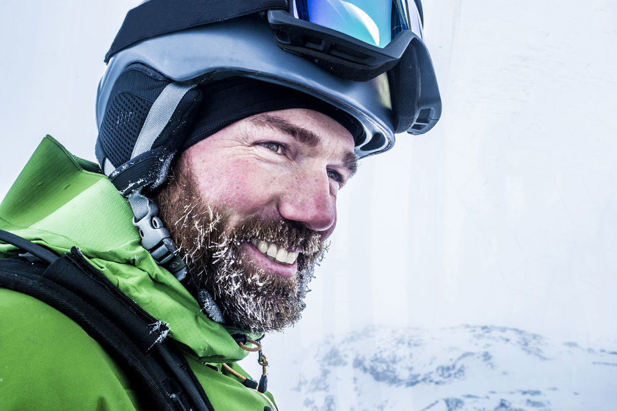 Portrait of happy male skier with iced beard in cable car Cable Car Extreme Holiday Lucky Man Ski Lift View Alps Bayern Beard Cold Cold Temperature Freeskiing Helmet Iced Lifestyles Mustache Pitztal Portrait Real People Ski Ski Goggles Ski Resort  Snow Winter