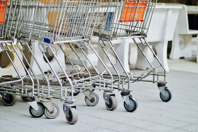 Close-up of empty shopping carts at store