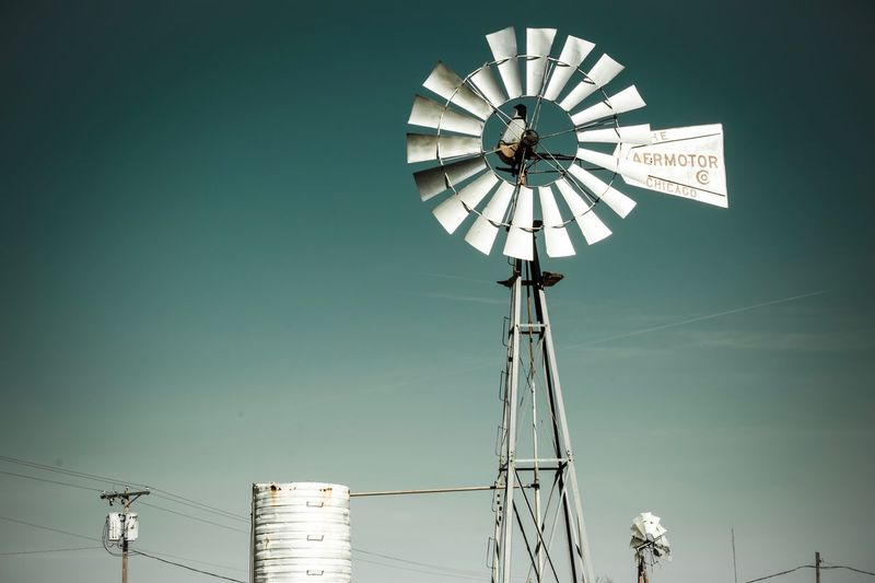 Low Angle View Renewable Energy Fuel And Power Generation Wind Power Alternative Energy No People Wind Turbine Day Windmill Outdoors Technology Nature Industrial Windmill Sky Clear Sky