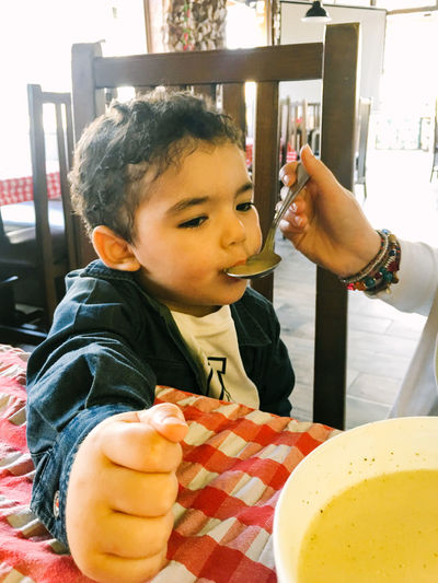 Baby Babyboy Boy Childhood Close-up Eat Eating Eating Food Food And Drink Freshness Haelthy Human Hand Indoors  Mother Plate Ready-to-eat Real People Restaurant Soup Soup Bowl Sweet Food Table Togetherness Two People