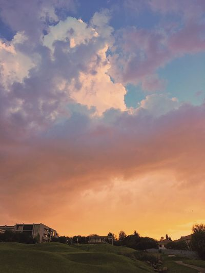 Sunset in the city over a golf course, Johannesburg. Architecture Beauty In Nature Building Exterior Built Structure Cloud - Sky Day Field Golf Course House Landscape Nature No People Outdoors Scenics Sky Sunset Tranquil Scene Tranquility Tree