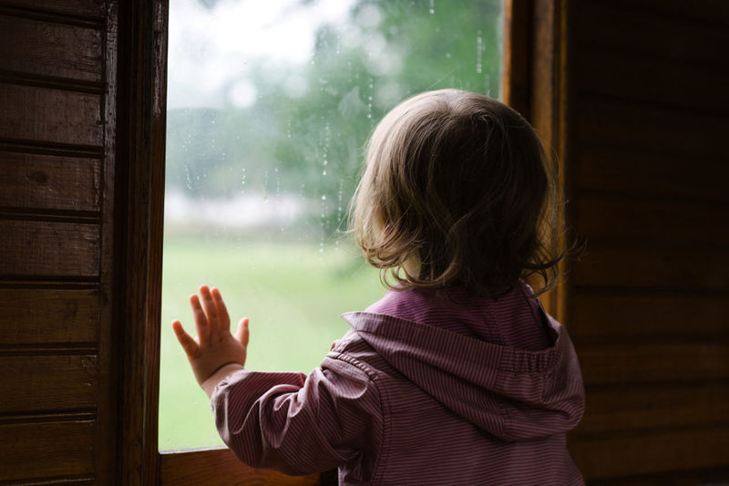 On the only rainy day of our vacation in summer 2016 we took a tour on the historic steam train between Mariefred and Taxinge Castle – good choice. Focus On Foreground Childhood One Person Child Window Rain Hand Waist Up Standing Looking Through Window Glass - Material Steam Train Innocence Day Looking Raindrops Summer Green Sweden Södermanland Sörmland Indoors  Children Headshot Blond Hair