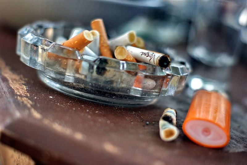 Cigarette  Ashtray  Bad Habit Warning Sign Close-up Healthcare And Medicine Sign Social Issues Table Communication Smoking Issues Narcotic Still Life Indoors  Selective Focus RISK Cigarette Butt Sharp No People Poisonous Sashalmi Saturdaynight