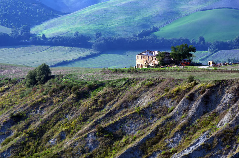 Scenic view of landscape and houses against mountains