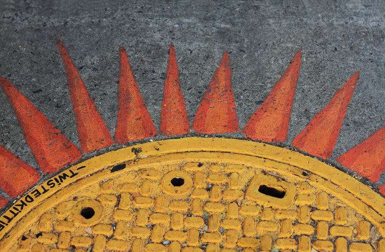 SUNNY MANHOLE City Orange Close-up Manhole  Painted Sun Streetshot Urban Photography Yellow