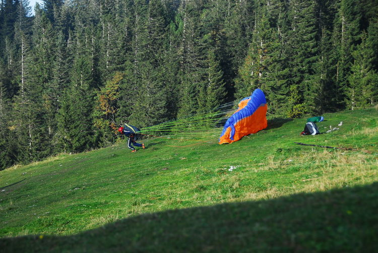 Person Launching Parachute On Field