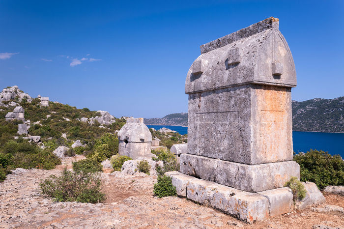Sarcophagi of ancient Lycians. Shot on top of a hill in Kaleköy, Kekova, Turkey Ancient Architecture Blue Diminishing Perspective History Kalekoy Kas Landscape Landscape_Collection Landscape_photography Lycian Tomb Mountain Natanomalous.com Nature Outdoors Sarcophagus Sea And Sky Seascape Sunlight The Past Tomb Tourism Tranquil Scene Tranquility Travel Destinations