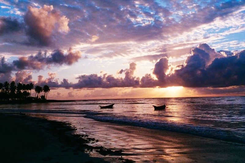 The sun goes down but we all know it never fails coming back up! Sunset Sea Cloud - Sky Sky Scenics Water Beach Beauty In Nature Nature Tranquil Scene No People Palm Tree Outdoors Horizon Over Water Tranquility Colour Your Horizn