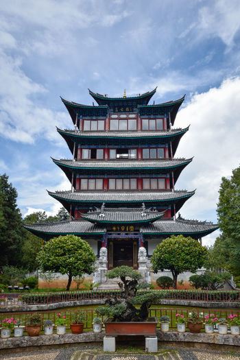 Pagoda Architecture Building Exterior Built Structure Cloud - Sky Cultures Day Eaves Lijiang Lion Hill Nature No People Outdoors Pagoda Place Of Worship Religion Sky Spirituality Tower Travel Destinations Tree Wanggu Yunnan Symmetry
