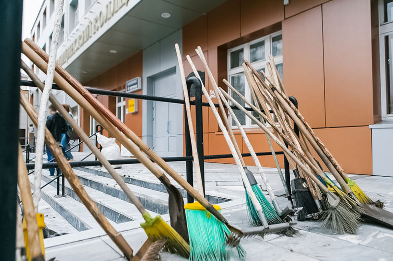 Shovels, brooms and rakes are a janitors inventory Indoors  No People Architecture Broom Day Wood - Material Home Interior Built Structure Still Life Railing Ladder Staircase Lifestyles Cleaning Door Cleaning Equipment Focus On Foreground Entrance Flooring Home Improvement Brooms  Shovels