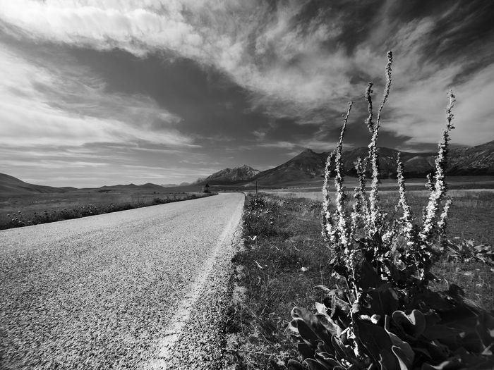 Campo Imperatore Gran Sasso Gran Sasso D'Italia Abruzzo Abruzzo Mountains Beauty In Nature Blackandwhite Blackandwhitephotography Cloud - Sky Day Environment Field Fineart Fineartphotography Land Landscape Mountain Nature No People Non-urban Scene Outdoors Plant Road Scenics - Nature Sky Tranquil Scene Tranquility Transportation