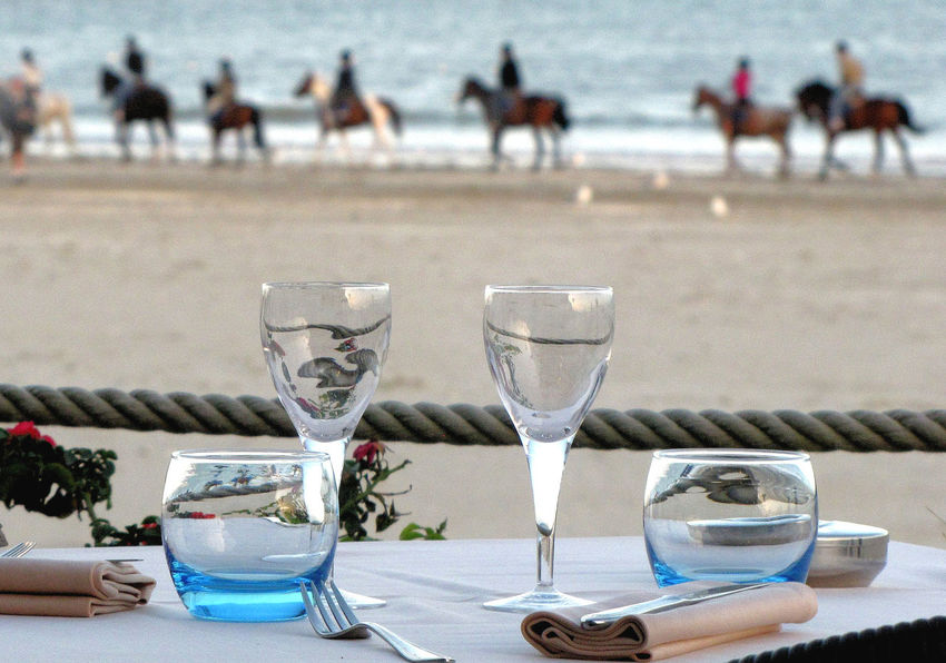 France Horses Napkins Rope Sophisticated Atlantic Coast Beach Blue Glasses Drinking Glass Focus On Foreground French Dining French Food Gastronomic Horses On A Beach La Baule La Baule Escoublac Restaurant Restaurant On The Beach Table For Lunch Table Looking Out On A Beach Weekend Breaks Weekends Away Wine Glases