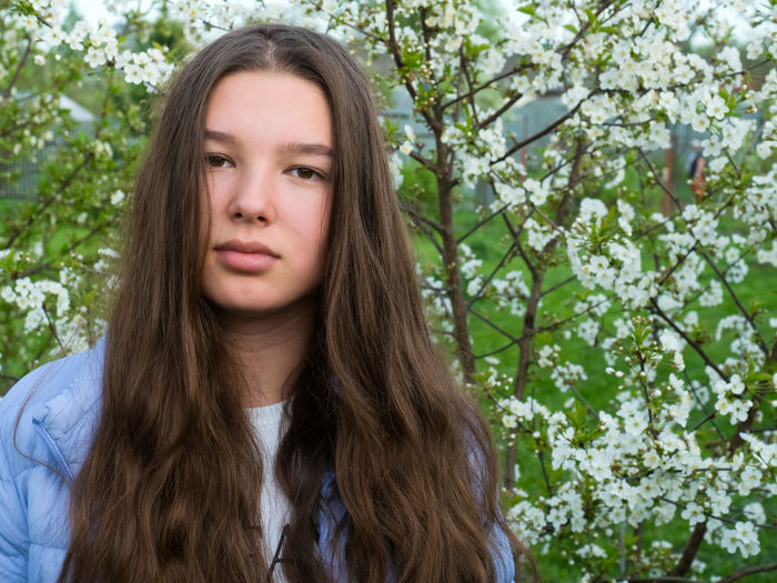 Portrait Long Hair Headshot Plant One Person Hair Hairstyle Tree Front View Young Adult Day Looking At Camera Young Women Brown Hair Lifestyles Nature Leisure Activity Real People Outdoors Beautiful Woman Teenager Contemplation