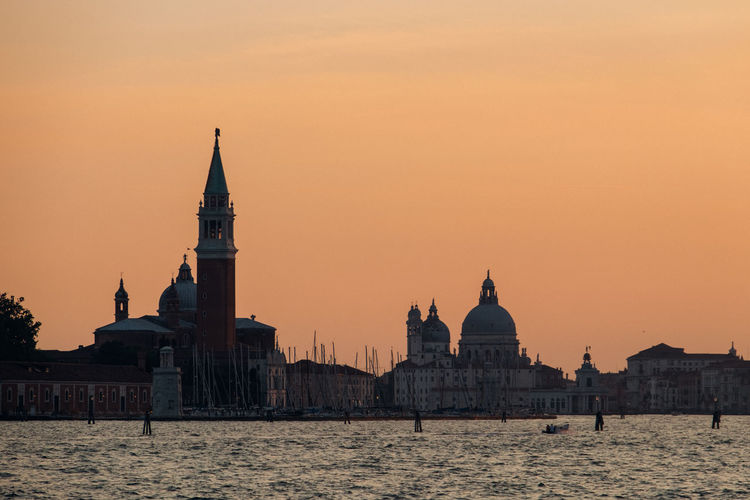 Sea in front of san giorgio maggiore church against sky during sunset