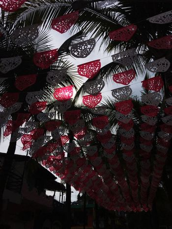 Street art in Mexico Paper Cutouts Red And White Paper Decorations Hanging Celebration Low Angle View Lantern Red