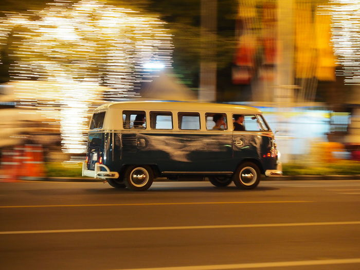 Vintage car on road in city at night