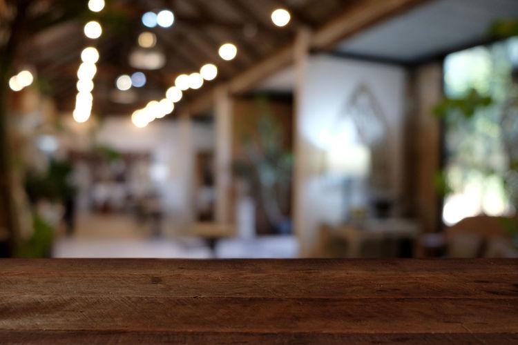 Close-up of illuminated lamp on wooden floor