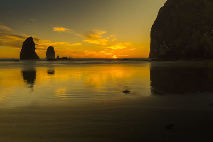 Sunset at Haystack Rock. Long exposure gives water a great reflection of the sky. Haystack Rock Beauty In Nature Nature No People Ocean Outdoors Reflection Scenics Sky Sunset Tranquility Water Oregon Explored Oregon Coast Oregon Sunset