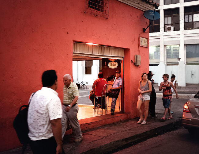 Adult Bar Building Exterior Colombia Happy Hour Leisure Activity Men Outdoors People Pub Red Social Gathering Street Streetphotography Twilight