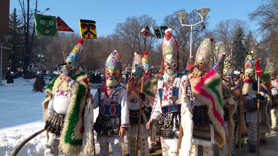 People Wearing Costumes On Street During Traditional Festival