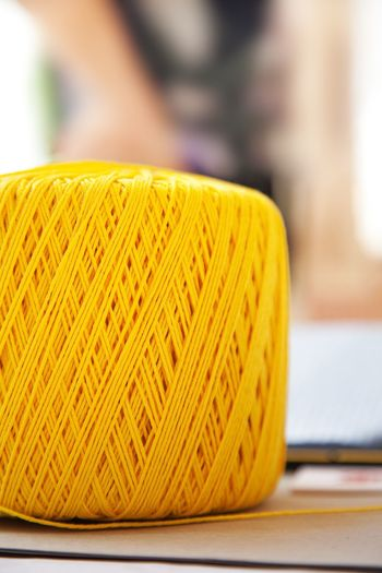 Yellow ball Knitter Yellow Color Colorful Object Hobby Homemade Handmade Vertical Vivid Knitting Wool Knitting Material Detail Cotton Yellow Focus On Foreground Close-up Textile Art And Craft Thread Table Still Life Pattern Clothing Single Object Creativity Craft Design Wool Softness