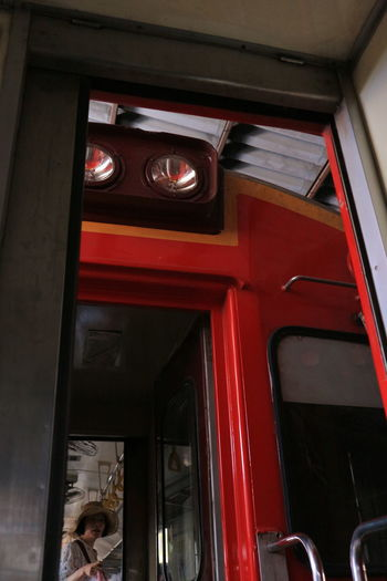 Low angle view of red door of building