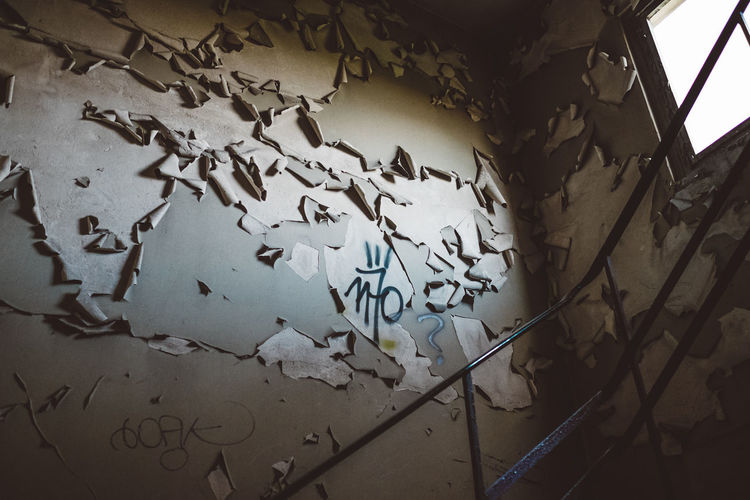 Old Wall Wall Wall Art Abandoned Abondoned Buildings Architecture Built Structure Close-up Communication Damaged Day Indoors  Low Angle View Moody No People Paper Staircase stairways Text