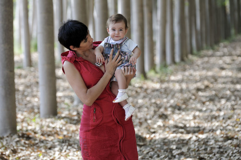 Mother and her little daughter enjoyoing a forest Two People Women Emotion Standing Three Quarter Length Togetherness Child Females Adult Family Bonding Childhood Smiling Day Positive Emotion People Happiness Love Focus On Foreground Men Hairstyle