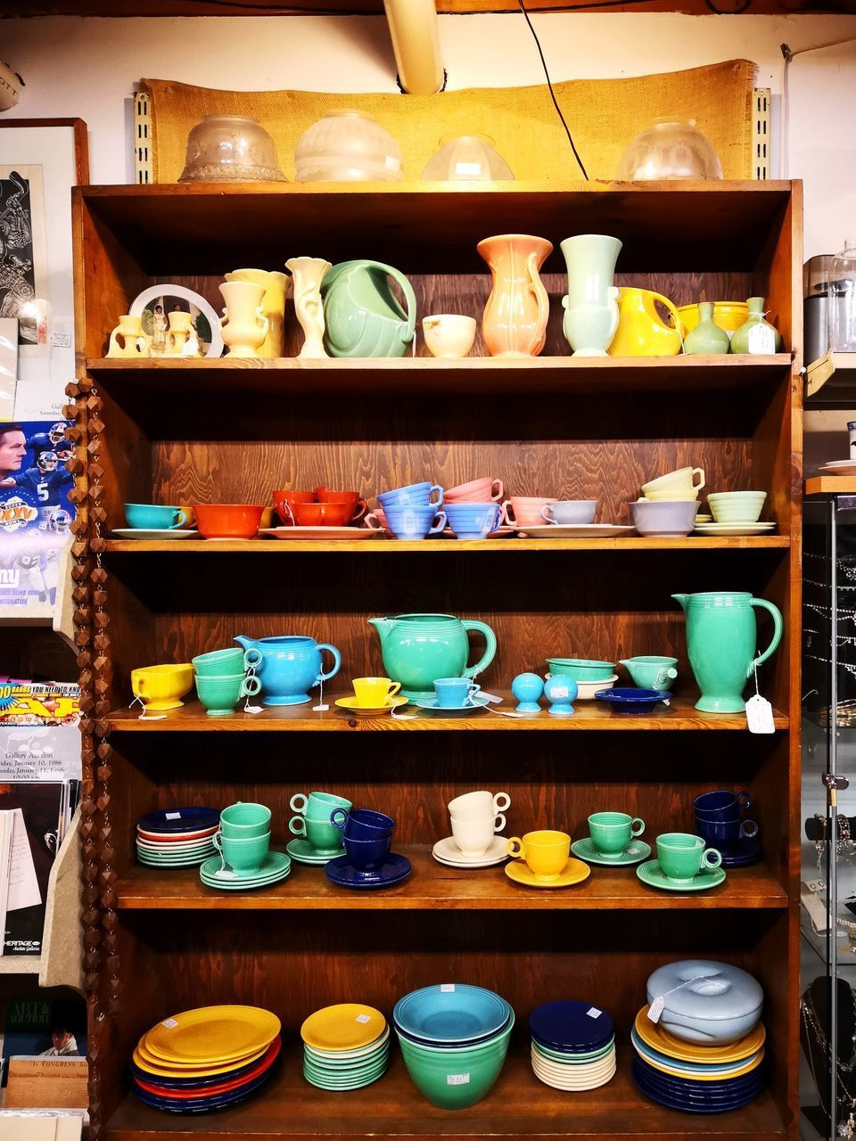 shelf, large group of objects, choice, variation, arrangement, for sale, container, no people, order, abundance, retail, indoors, still life, shelves, rack, shopping, side by side, in a row, kitchen utensil, collection, crockery, cabinet