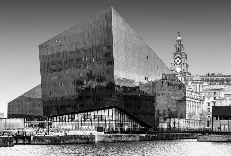 Liverpool docks Built Structure Building Exterior Architecture Water Sky City Waterfront Nature Building River Day No People Outdoors Clear Sky Reflection Connection Travel Destinations Bridge
