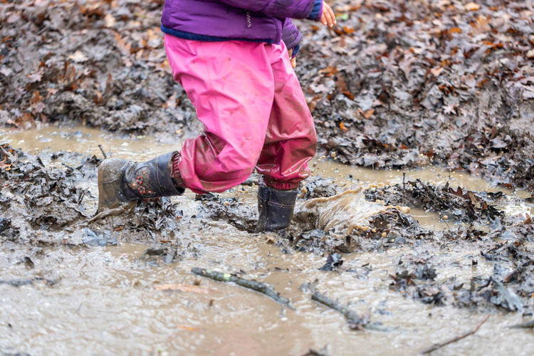 Outdoors Low Section Mud Muddy Water Playing Dirty Splashing Child Childhood Children Boots Waterproof Fun Play