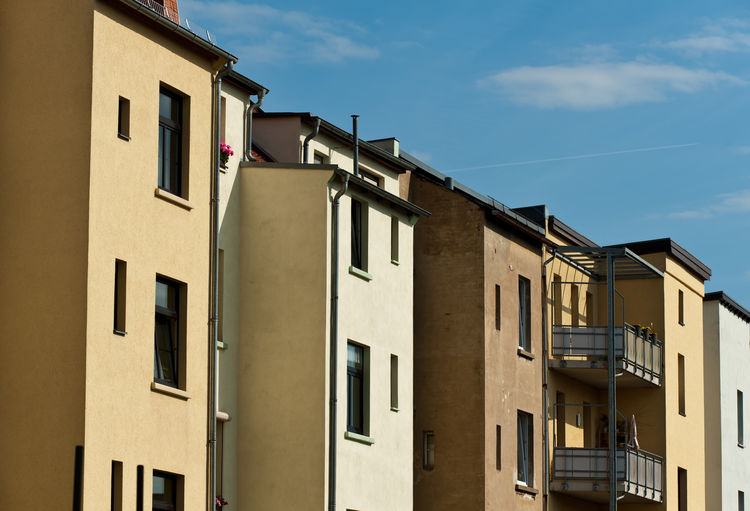 old rental houses in leipzig Building Exterior Architecture Built Structure Window Sky Residential District Building Low Angle View No People Day Sunlight Nature Cloud - Sky Outdoors City House Blue Side By Side Shadow Sunny Apartment Rental Old Historic Historical Building