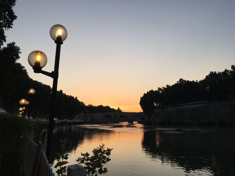Roman Sunset Scenics Tranquil Scene Riverbank Ancient City Summer Vibes Cityscape Reflection Baroque Architecture Roma Isola Tiberina Tiber River Eternal City Sunset Water Dusk Outdoors Clear Sky Illuminated