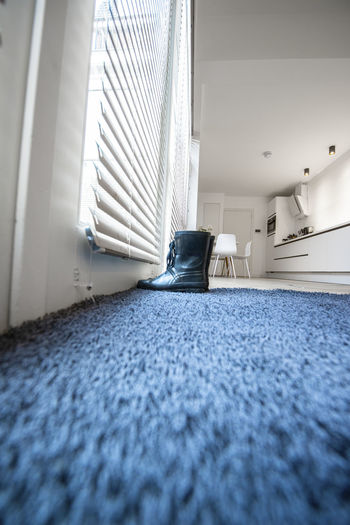 Indoors  Domestic Room Carpet - Decor No People Selective Focus Surface Level Blue Absence Architecture Day Home Interior Window Flooring Low Angle View Bedroom Lifestyles Focus On Background Furniture Building Clean