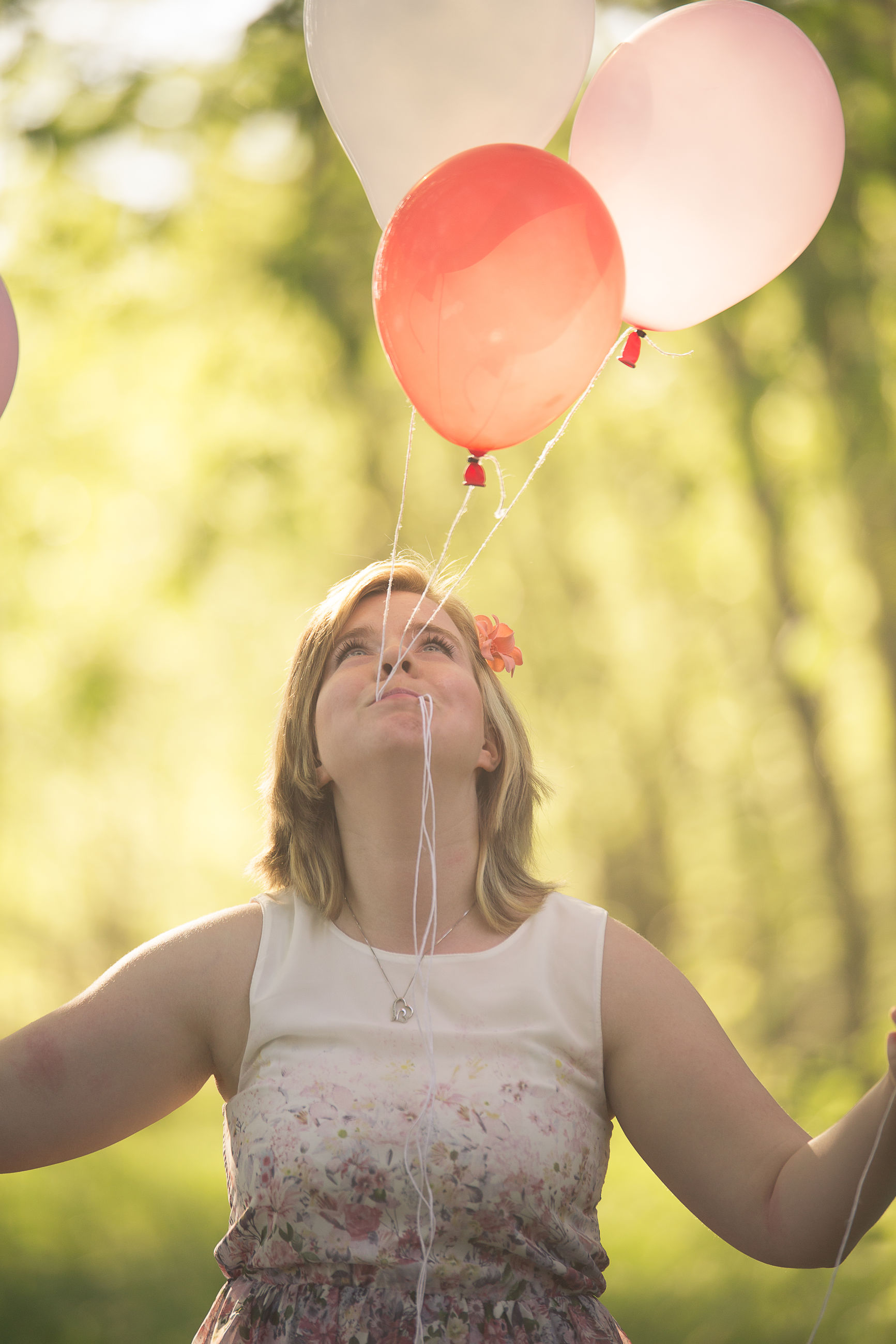 balloon, real people, one person, lifestyles, women, focus on foreground, day, leisure activity, helium balloon, females, front view, nature, child, emotion, waist up, portrait, casual clothing, standing, outdoors, positive emotion, hairstyle