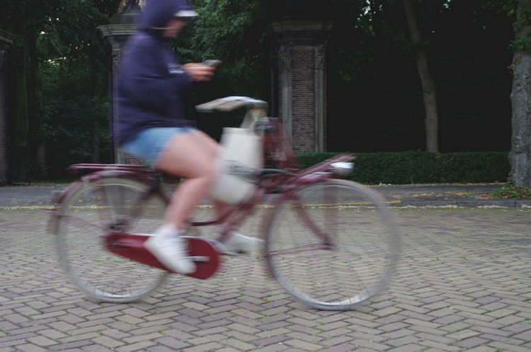 Bicycle Biker Blurred Motion Cycling Day Land Vehicle Lifestyles Men Mode Of Transport Motion Nature One Person Outdoors People Phone Real People Riding Smartphone Speed Technology Texting While Riding Transportation Urban