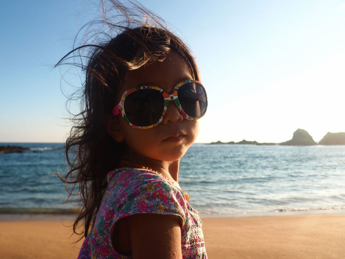 EyeEm Selects Sunglasses Children Only One Person One Girl Only Sea Beach Child Childhood People Headshot Girls Vacations Day Sky Portrait Summer Water Outdoors Sunlight Sunset Mazunte Mexico Candid Travel Destinations Sommergefühle