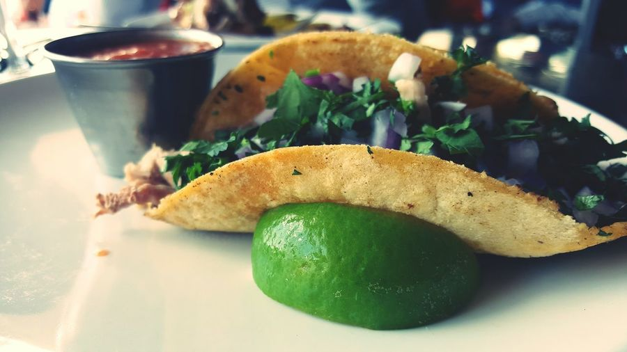 Close-up of taco with lime in plate