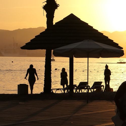Sea Water Beach Sunset Silhouette Nature Outdoors Leisure Activity Beauty In Nature Scenics Real People Lifestyles Tranquil Scene Group Of People Eilat Israel