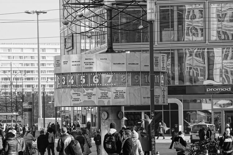 time around the world Alexanderplatz Architecture Berlin Building Exterior Built Structure Clock Communication Day Real People Sitting Streetphotography Time Universal Urban Weltzeituhr World